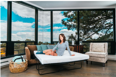Model Sitting on Deluxe Sofa Bed Mattress with Memory Foam
