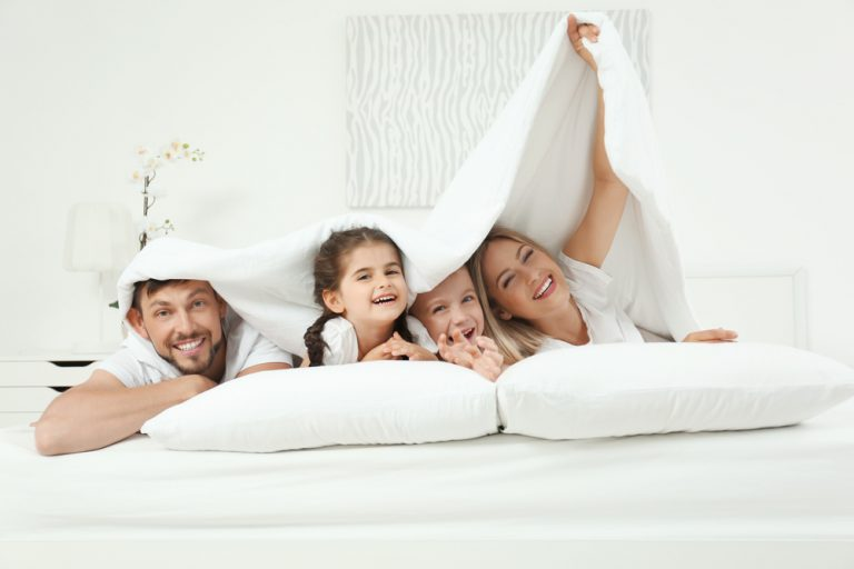 family of four in bed