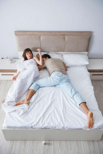 Couple sharing small bed